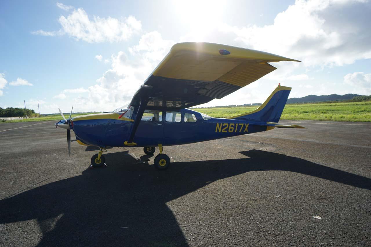 Blue and yellow aircraft sitting on the runway at La Zona Puerto Rico Skydiving