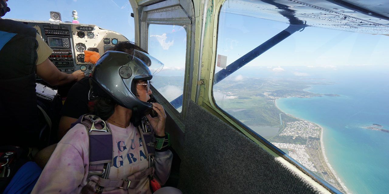 Female skydiver looks out to Puerto Rico's stunning east coast