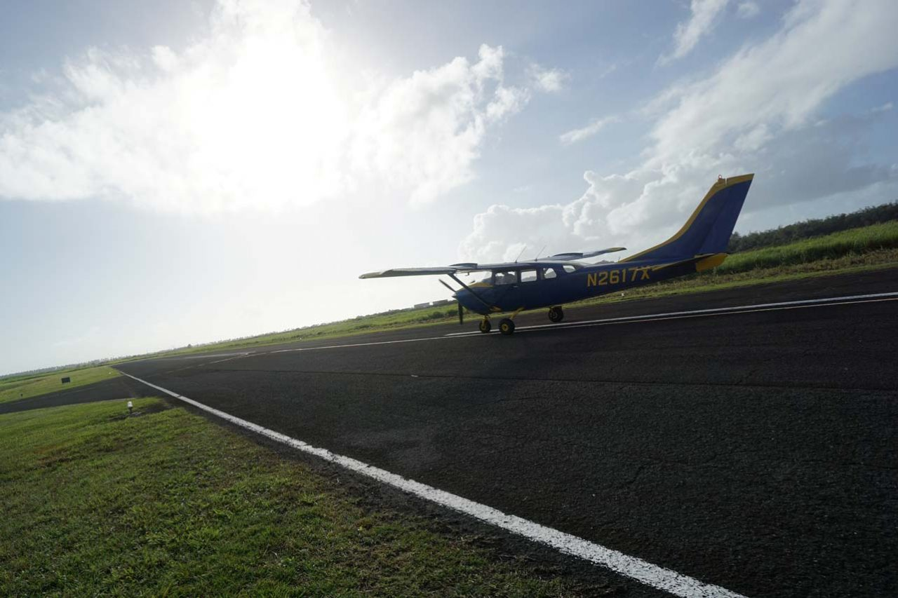 La Zona Puerto Rico Skydiving's blue and yellow aircraft sitting on the runway waiting for take off