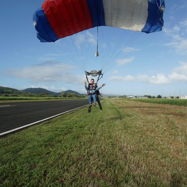 Female tandem skydiver comes in for landing after a beautiful skydive at La Zona Puerto Rico Skydiving