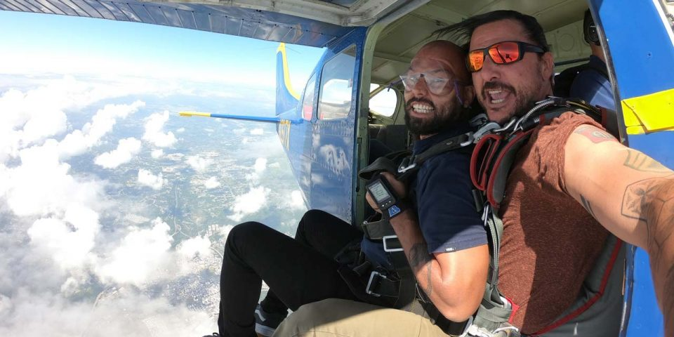 Tandem coach and skydiver smile at camera before leaping out of the La Zona Puerto Rico Skydiving aircraft