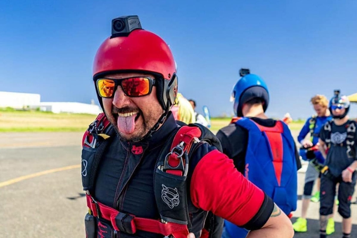 Co-owner of La Zona Puerto Rico Skydiving, Felipe, wearing a red helmet and jump suit