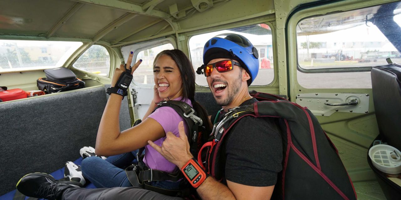 Female tandem student and instructor preparing to tandem skydive in Puerto Rico at La Zona Puerto Rico in Humacao