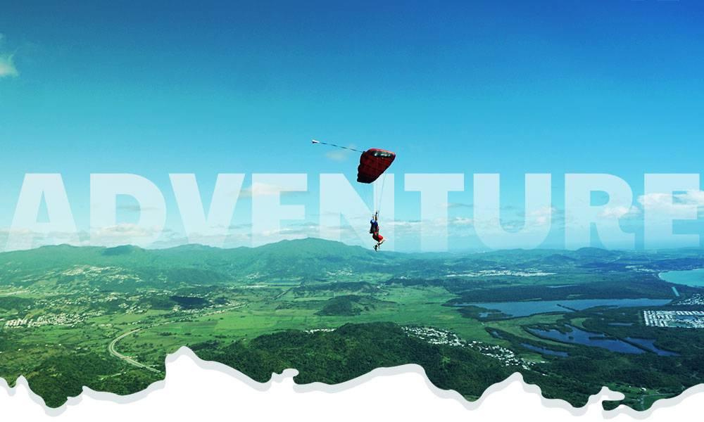 Experienced skydiver flies over Puerto Rico's lush El Yunque Rain Forest