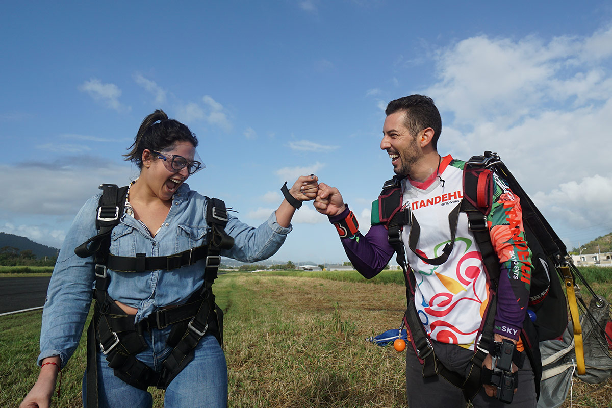 Co-owner of La Zona Puerto Rico SKydiving, Francisco, fist bumps his tandem student after an awesome skydive