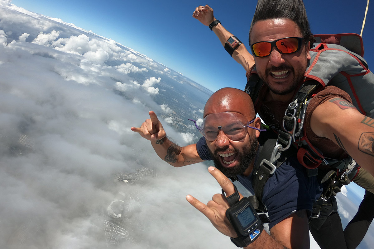 Male tandem skydiver wearing clear goggles excited to be skydiving with La Zona Puerto Rico Skydiving coach