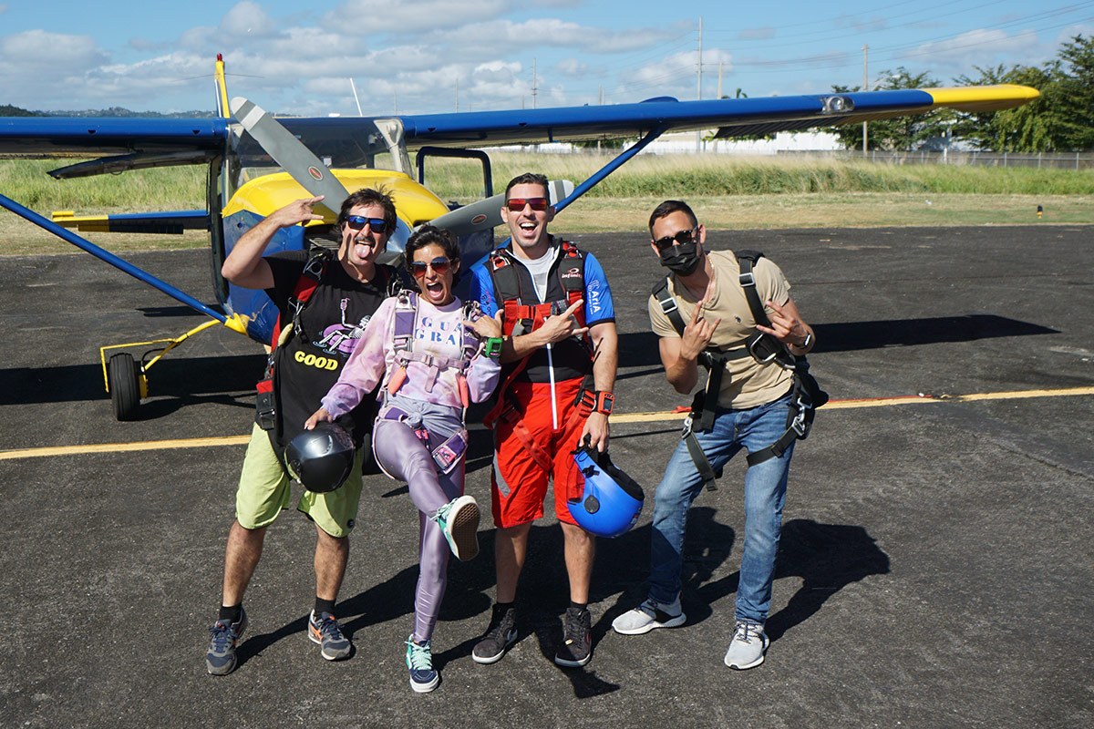 Experienced skydivers making silly faces in front of the La Zona Puerto Rico Skydiving aircraft